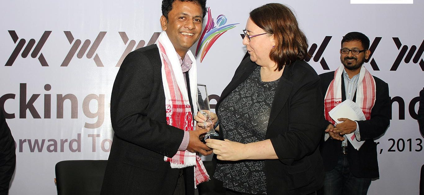 Syed Sajjad Ali, Editor of Indigenous Herald, receives the Impulse Model Media Award for Change Makers 2013, from Ms. Helen LaFave, Consul General of the US Consulate in Kolkata